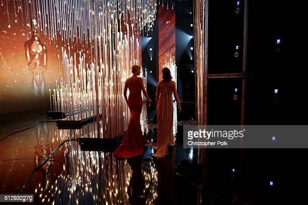 Actresses Charlize Theron and Emily Blunt walk onstage at the 88th Annual Academy Awards at Dolby Theatre on February 28 2016 in Hollywood California
