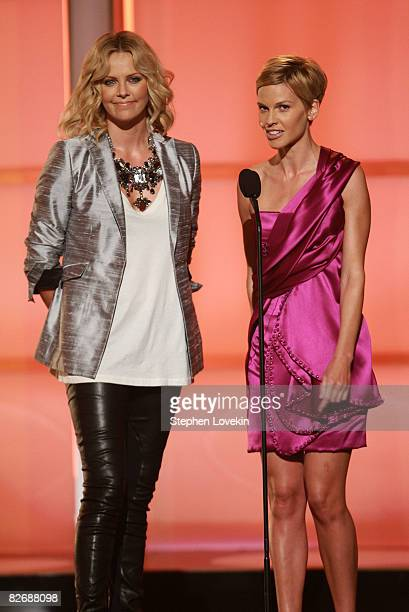 Actresses Charlize Theron and Hilary Swank speak on stage during the Conde Nast Media Group's Fifth Annual Fashion Rocks at Radio City Music Hall on...