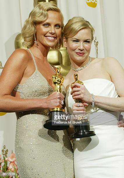 Actresses Charlize Theron and Renee Zellweger pose with their Oscars for Best Actress and Best Supporting Actress during the 76th Annual Academy...