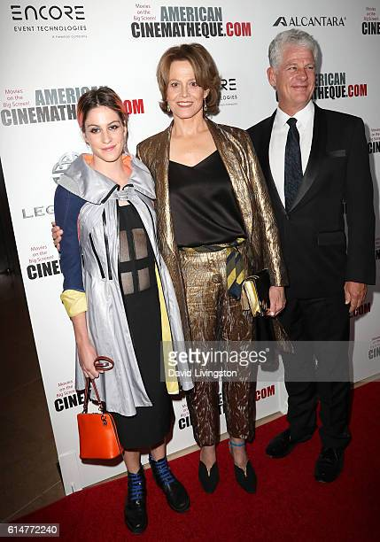 R Actresses Charlotte Simpson and Sigourney Weaver and director Jim Simpson arrive at the 30th Annual American Cinematheque Awards Gala at The...