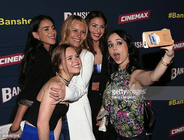 Actresses Cherie Jimenez Ryann Shane Tanya Clarke Ana Ayora and Eliza Dushku pose for a selfie at the premiere of Cinemax's 'Banshee' 4th Season at...