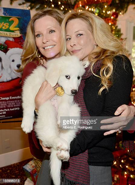 Actresses Cheryl Ladd and Jordan Ladd attend the 'Santa Paws 2 The Santa Pups' holiday party hosted by Disney Cheryl Ladd and Ali Landry at The...