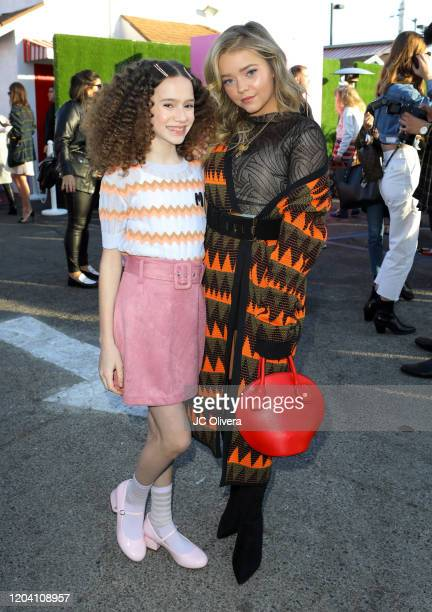Actresses Chloe Coleman and Jade Pettyjohn attend M Missoni F/W20 presentation at Pink's Hot Dogs on February 04 2020 in Los Angeles California
