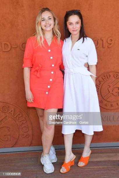 Actresses Chloe Jouannet and Lola Le Lann attend the 2019 French Tennis Open - Day Seven at Roland Garros on June 01, 2019 in Paris, France.
