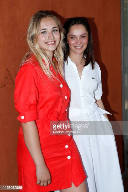 Actresses Chloe Jouannet and Lola Le Lann attends the 2019 French Tennis Open - Day Seven at Roland Garros on June 01, 2019 in Paris, France.