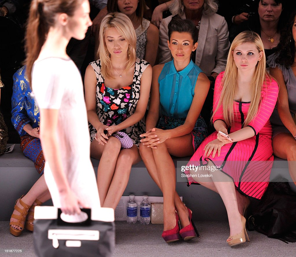 Actresses Christian Serratos, India de Beaufort and Abigail Breslin attend the Nanette Lepore Spring 2013 fashion show during Mercedes-Benz Fashion Week at The Stage Lincoln Center on September 12, 2012 in New York City.