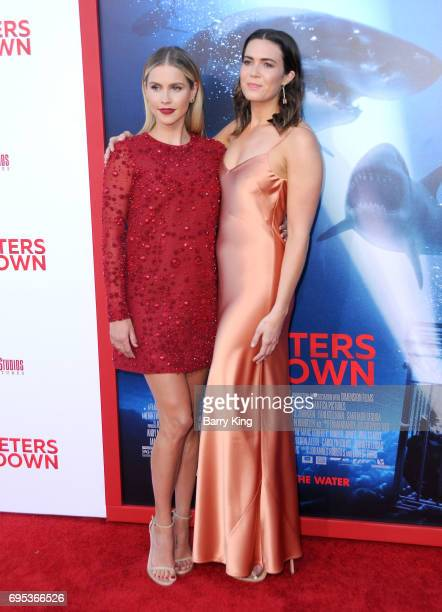 Actresses Claire Holt and Mandy Moore attend the Premiere of Dinemsion Films' '47 Meters Down' at Regency Village Theatre on June 12 2017 in Westwood...