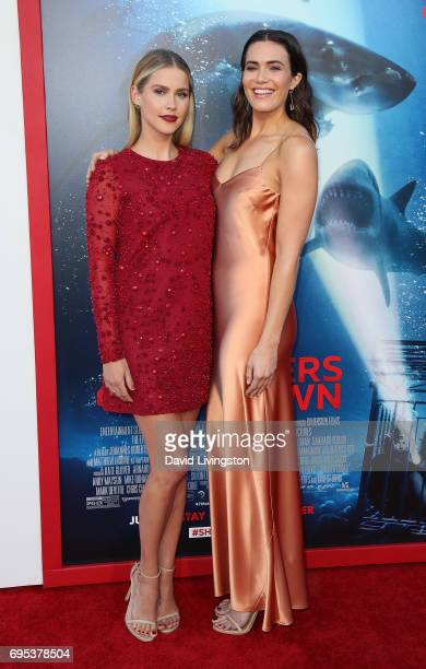 Actresses Claire Holt and Mandy Moore attend the premiere of Dimension Films' '47 Meters Down' at Regency Village Theatre on June 12 2017 in Westwood...