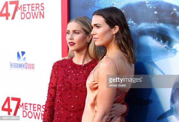 Actresses Claire Holt and Mandy Moore attend the Premiere of Dimension Films' '47 Meters Down' at the Regency Village Theatre on June 12 2017 in...