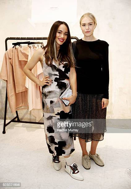 Actresses Cleopatra Coleman and Penelope Mitchell wearing Juliette Hogan designs attend the Juliette Hogan SS16 showcase at NuSpace on April 21 2016...