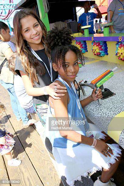 Actresses Cree Cicchino and Riele Downs play a round at the Top Glow Booth during the 17th Annual Mattel Party on the Pier on September 25 2016 in...