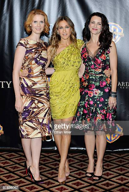 Actresses Cynthia Nixon Sarah Jessica Parker and Kristin Davis arrive at the Warner Bros Pictures presentation to promote their new film Sex and the...