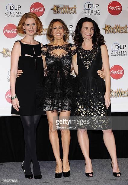 Actresses Cynthia Nixon, Sarah Jessica Parker and Kristin Davis recipients of the Ensemble Award arrive at the ShoWest awards ceremony at Paris Las...
