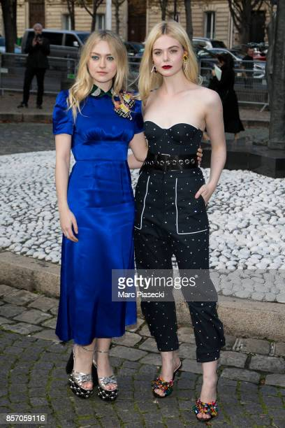 Actresses Dakota Fanning and Elle Fanning attend the 'Miu Miu' fashion show on October 3 2017 in Paris France
