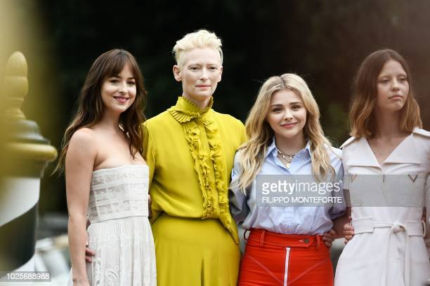 Actresses Dakota Johnson Tilda Swinton Chloe Grace Moretz and Mia Goth pose after they arrived by boat at the Excelsior Hotel's pier on September 1...