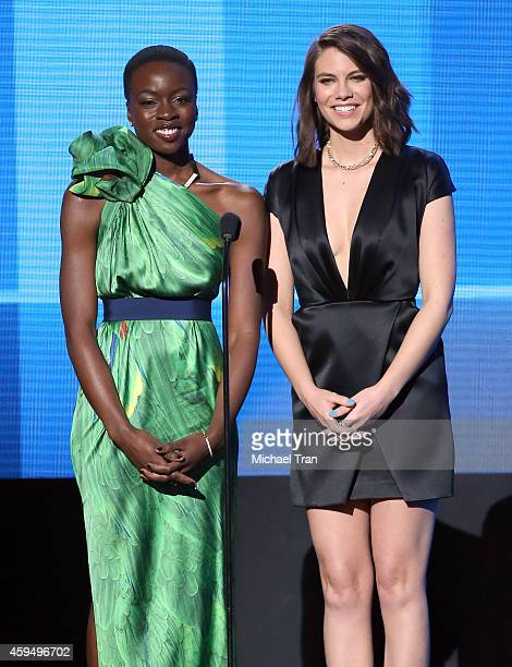 Actresses Danai Gurira and Lauren Cohan speaks onstage during the 2014 American Music Awards held at Nokia Theatre LA Live on November 23 2014 in Los...