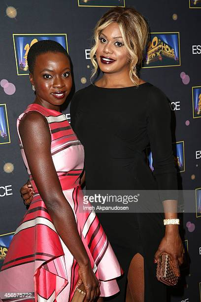 Actresses Danai Gurira and Laverne Cox attend the Essence 'A Toast To Primetime' event at Herringbone Mondrian LA on October 2 2014 in Beverly Hills...