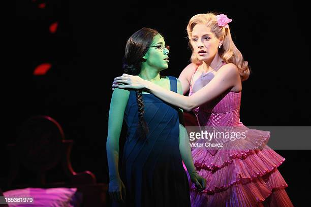 Actresses Danna Paola and perform Cecilia de la Cueva on stage during the musical Wicked media call at Teatro Telmex on October 18 2013 in Mexico...
