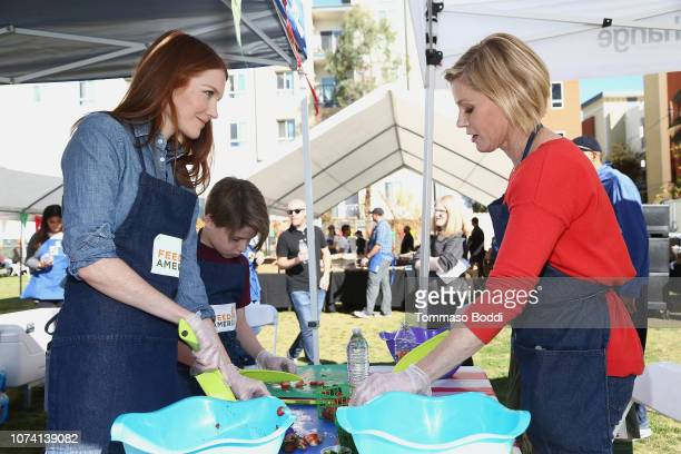Actresses Darby Stanchfield and Julie Bowen attend the Celebrity Friends Volunteer With Feeding America At Para Los Niños' Felices Fiestas...