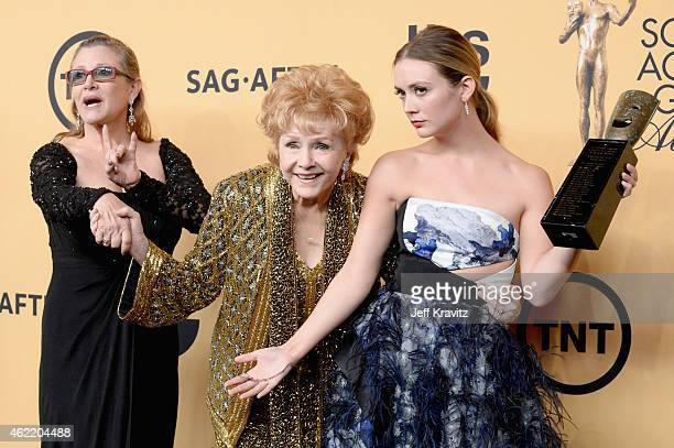 Actresses Debbie Reynolds Carrie Fisher and Billie Lourd pose in the press room at the 21st Annual Screen Actors Guild Awards at The Shrine...