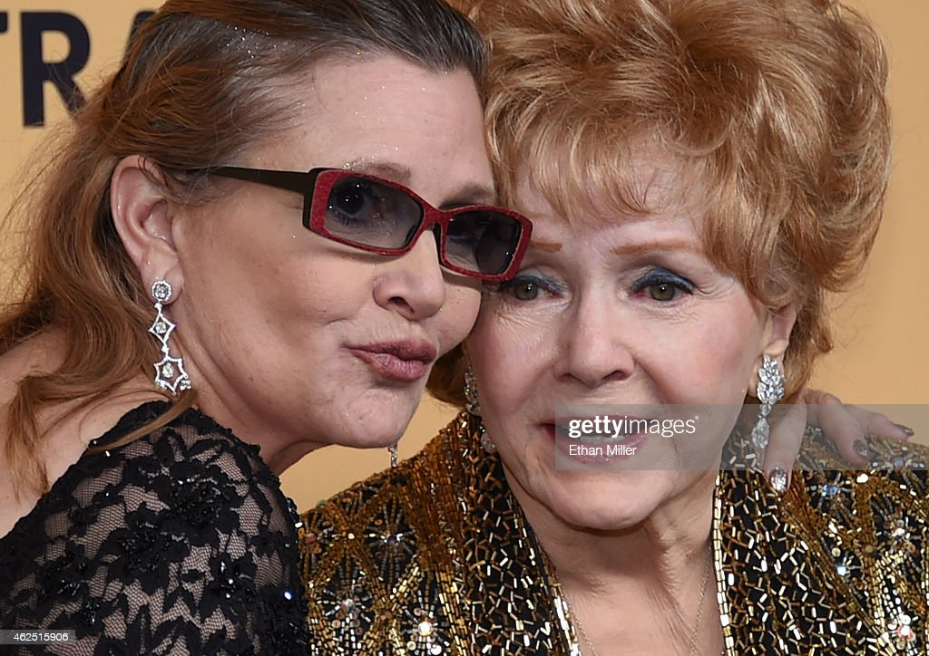 Actresses Debbie Reynolds (R), recipient of the Screen Actors Guild Life Achievement Award, and her daughter Carrie Fisher pose in the press room during the 21st Annual Screen Actors Guild Awards at The Shrine Auditorium on January 25, 2015 in Los Angeles, California.