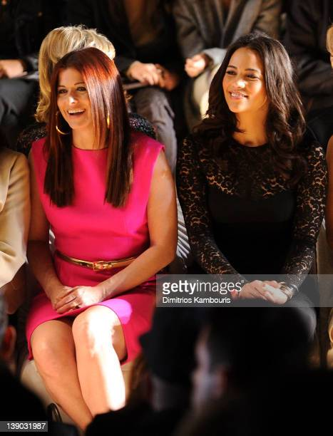 Actresses Debra Messing and Paula Patton attend the Michael Kors Fall 2012 fashion show during MercedesBenz Fashion Week at The Theatre at Lincoln...