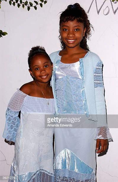 Actresses DeeDee and Aree Davis arrive at the Fox TV Emmy After Party at Mortons on September 21 2003 in West Hollywood California