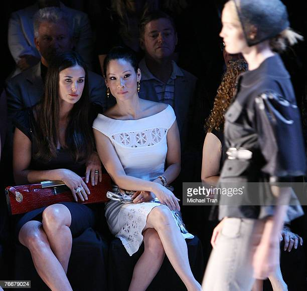 Actresses Demi Moore and Lucy Liu front row at Zac Posen Spring 2008 Collection during Mercedes-Benz Fashion Week at The Tent in Bryant Park on...