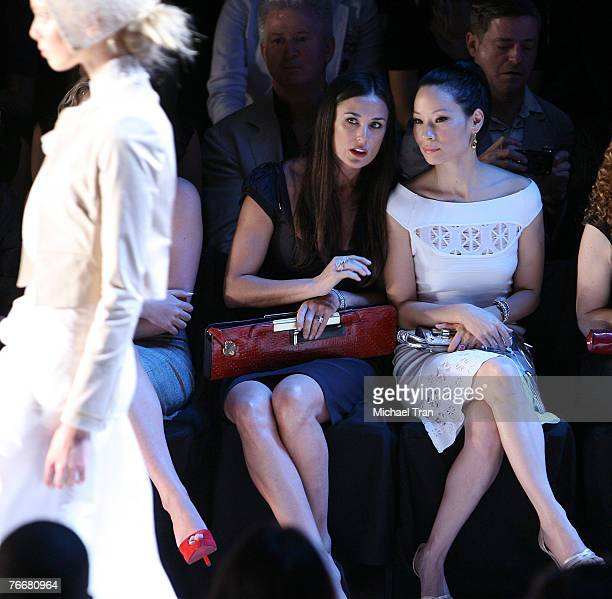 Actresses Demi Moore and Lucy Liu, front row at Zac Posen Spring 2008 Collection during Mercedes-Benz Fashion Week at The Tent in Bryant Park on...