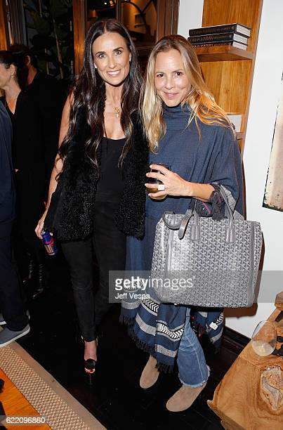 Actresses Demi Moore and Maria Bello attend the Urban Zen LA Opening on November 9 2016 in Los Angeles California