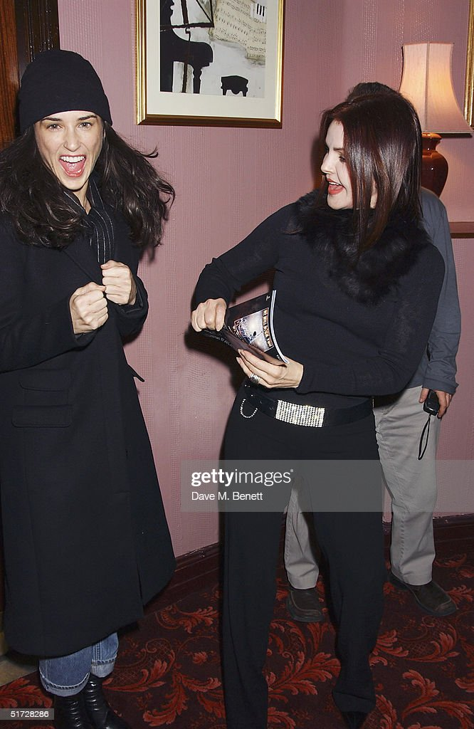 Actresses Demi Moore and Priscilla Presley backstage after seeing 'We Will Rock You', the Queen musical at the Dominion Theatre on November 10, 2004 in London. Demi Moore is in London filming with her daughters and Priscilla Presley is in London to receive the UK Rock 'n' Roll Hall of Fame for her ex-husband Elvis. (Photo by Dave Benett/Getty Images).