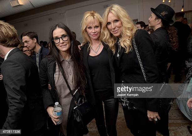 Actresses Demi Moore Melanie Griffith and producer Alana Stewart attend We Alone a photography exhibit by Bryan Fox at Think Tank Gallery on May 9...