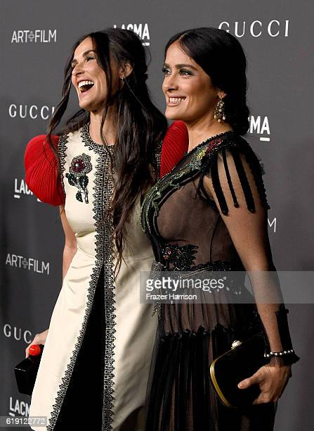 Actresses Demi Moore wearing Gucci and Salma Hayek attend the 2016 LACMA Art Film Gala honoring Robert Irwin and Kathryn Bigelow presented by Gucci...