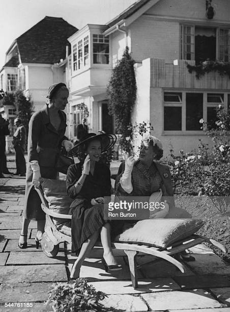 Actresses Diana Wynyard Sally Anne Howes and Cicely Courtneidge at the opening of a theatrical convalescence home at the home of Ivor Novello at...