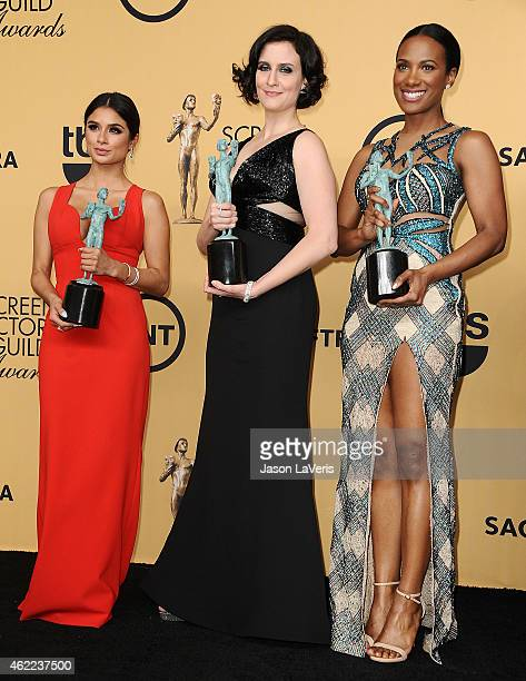 Actresses Diane Guerrero Julie Lake and Vicky Jeudy pose in the press room at the 21st annual Screen Actors Guild Awards at The Shrine Auditorium on...