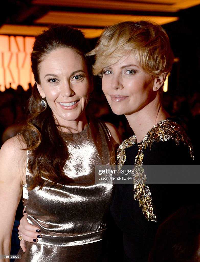 Actresses Diane Lane (L) and Charlize Theron, wearing Ferragamo, attend the Wallis Annenberg Center for the Performing Arts Inaugural Gala presented by Salvatore Ferragamo at the Wallis Annenberg Center for the Performing Arts on October 17, 2013 in Beverly Hills, California.