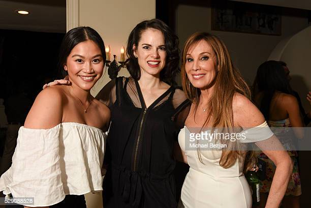 Actresses Dianne Doan and Amy Bailey with producer Cindy Cowan pose for portrait at Cindy Cowan's Birthday Party on May 7 2016 in Los Angeles...