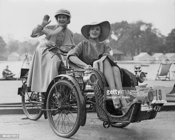 Actresses Dinah Sheridan and Kay Kendall film a scene for the comedy 'Genevieve' on a 1903 Humber Forecar in Hyde Park London 23rd September 1952