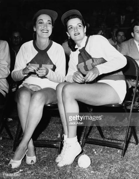 Actresses Dorothy Lamour and Jane Russell during a celebrity baseball game, circa 1947.