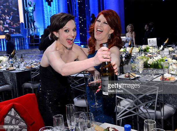 Actresses Elisabeth Moss and Kate Flannery attend the 19th Annual Screen Actors Guild Awards cocktail reception at The Shrine Auditorium on January...