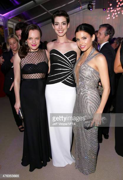 Actresses Elisabeth Moss Anne Hathaway and Jenna DewanTatum attend the 2014 Vanity Fair Oscar Party Hosted By Graydon Carter on March 2 2014 in West...