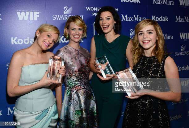 Actresses Elisabeth Moss January Jones Jessica Pare and Kiernan Shipka attend Women In Film's 2013 Crystal Lucy Awards at The Beverly Hilton Hotel on...