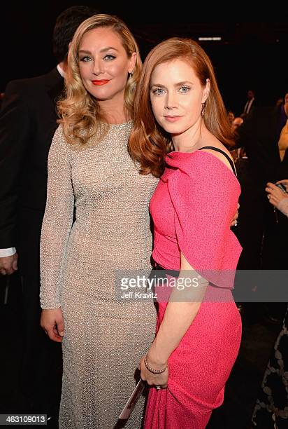 Actresses Elisabeth Rohm and Amy Adams attend the 19th Annual Critics' Choice Movie Awards at Barker Hangar on January 16 2014 in Santa Monica...