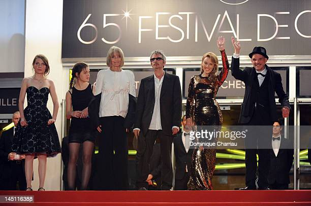Actresses Elise Lhomeau Jeanne Dissone Edith Scob director Leos Carax actress and singer Kylie Minogue and actor Denis Lavant attend the Holy Motors...