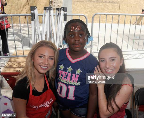 Actresses Elise Luthman and Ava Cantrell participate in the Los Angeles Mission's End Of Summer Arts And Education Fair held at Los Angeles Mission...