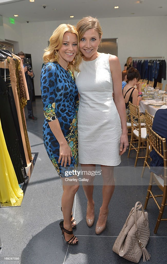 Actresses Elizabeth Banks (L) and Sarah Chalke attend Versace, Vanity Fair, And Elizabeth Banks Luncheon Benefitting Vital Voices Global Partnership at Versace on May 22, 2013 in Beverly Hills, California.