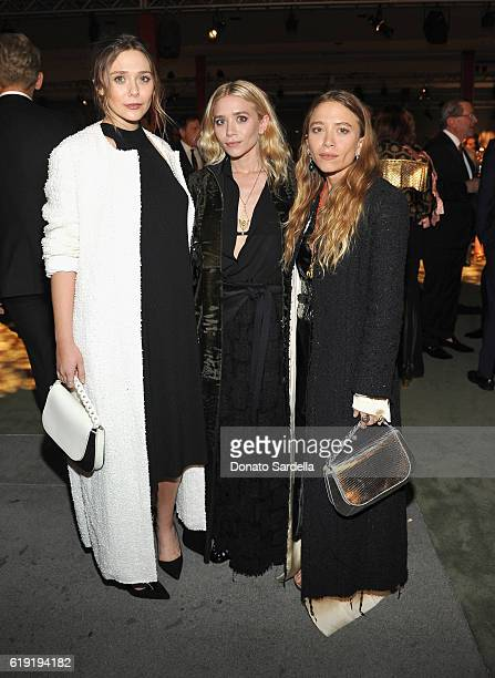 Actresses Elizabeth Olsen Ashley Olsen and Mary Kate Olsen attend the 2016 LACMA Art Film Gala Honoring Robert Irwin and Kathryn Bigelow Presented By...