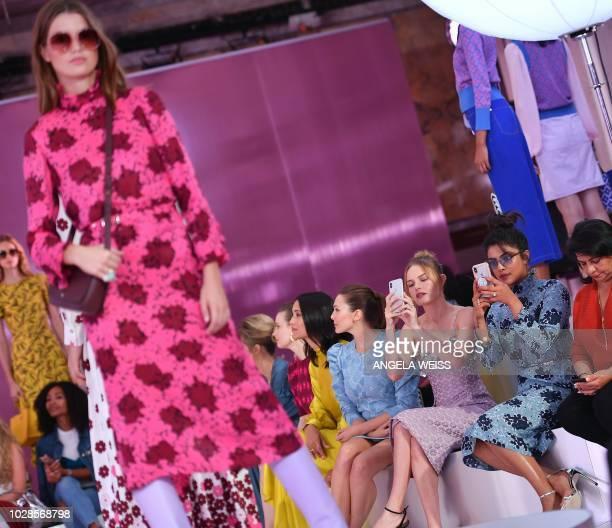 Actresses Elizabeth Olsen Kate Bosworth and Priyanka Chopra attend the Kate Spade fashion show during New York Fashion Week at New York Public...