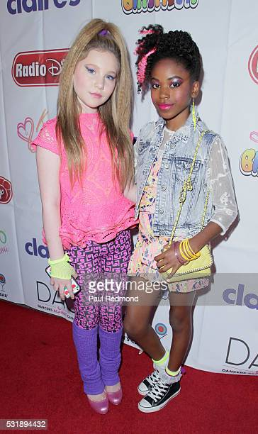 Actresses Ella Anderson and Riele Downs on the red carpet at JoJo Siwa from 'Dance Moms' 13th Birthday 80's Dance Party at Madame Tussauds on May 16...