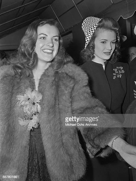 Actresses Ella Raines and Lois Andrews arrive at Mocambo's in Los Angeles California